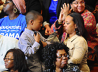 LAURA FONG |  A mother straightens her son's tie while 2,000 Democratic supporters awaited a visit from First Lady Michelle Obama at Cuyahoga Community College in Cleveland Monday.