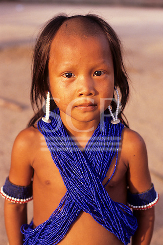 A-ukre village, Brazil. Kayapo boy wearing lots of blue beads; Xingu Indigenous Area, Para State.