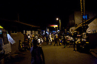 Ghanaians walk in their neighborhood while awaiting for the 50th anniversary of their countries' independence in the Jamestown neighborhood in Accra, Ghana on Sunday March 04 2007..