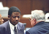Defense attorneys Carl E. Douglas, left, and F. Lee. Bailey, right, during the trial of former NFL star running back O.J. Simpson for the murder of his former wife, Nicole Brown Simpson and a friend of hers, restaurant waiter, Ron Goldman in Los Angeles County Superior Court in Los Angeles, California on July 13, 1995.<br /> Credit: Steve Grayson / Pool via CNP