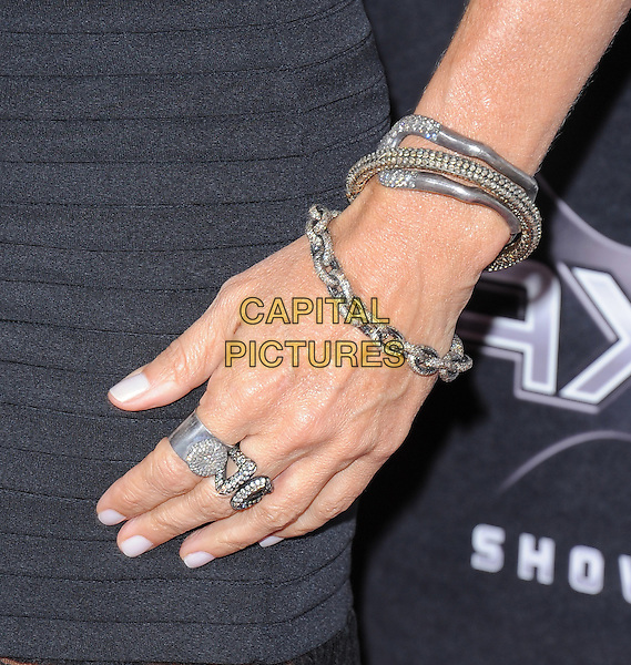 COURTENEY COX's hand .at the Weinstein World Premiere of 'Scream 4' held at The Grauman's Chinese Theatre in Hollywood, California, USa, April 11th 2011..detail ring rings  manicure silver bracelets.CAP/RKE/DVS.©DVS/RockinExposures/Capital Pictures.