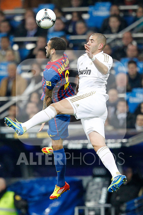 Real Madrid's Karim Benzema and FC Barcelona's Daniel Alves during spanish King's Cup on January 18th 2012...Photo: Cesar Cebolla / ALFAQUI