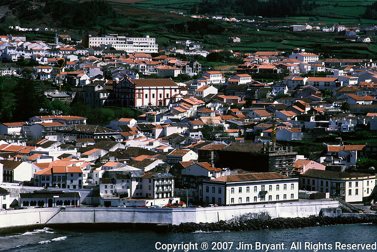 Beautiful Angra do Heroismo features whitewashed houses with orange colored roofs on Terceira, Azores. Angra, badly damaged by an earthquake in 1980, is one of the finest examples of Renaissance architecture and is the only entire town was put on the heritage lists by the United Nations Educational, Scientific and Cultural Organization. (Jim Bryant Photo)....