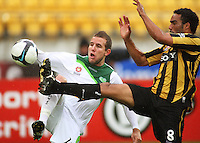 Fury's Jeremy Brockie and Phoenix' Paul Ifill compete for the ball. A-League football - Wellington Phoenix v North Queensland Fury at Westpac Stadium, Wellington. Friday, 15 January 2010. Photo: Dave Lintott / lintottphoto.co.nz.