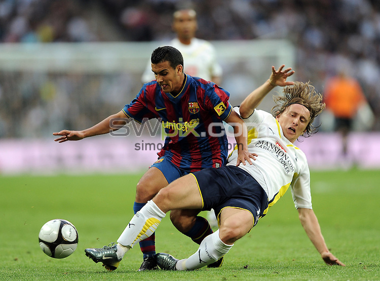 PICTURE BY JEREMY RATA/SWPIX.COM. Wembley Cup - Tottenham Hotspur v FC Barcelona, Wembley Stadium, London, England. 24th July 2009. Spur's Luca Modric tackles Barca's Pedro Rodriguez..Copyright - Simon Wilkinson - 07811267706