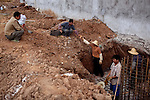 Construction workers work on a new casino, which is partially open, is being constructed on the Laos side of the the Mekong River opposite of Sop Ruak, Thailand. The land was rented from the government and displaced a Laos village. Photo taken on Thursday, December 10, 2009. Kevin German / Luceo Images