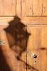shadow of a street lamp at a wooden door<br /> <br /> sombra de una linterna en una puerta de madera<br /> <br /> Schatten einer Stra&szlig;enlaterne auf einer Holzt&uuml;r