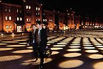 A couple walks past renovated warehouses in Yokohama, Japan. The area around the red brick warehouses, which date back over a century and now house boutiques and restaurants, have been lit up for the yearend period.