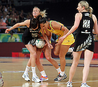 16.09.2012 Silver Ferns Anna Harrison and Australian Kim Green and Mo'onia Gerrard in action during the first netball test match between the Silver Ferns and the Australian Diamonds played at the Hisense Arena In Melbourne. Mandatory Photo Credit ©Michael Bradley.