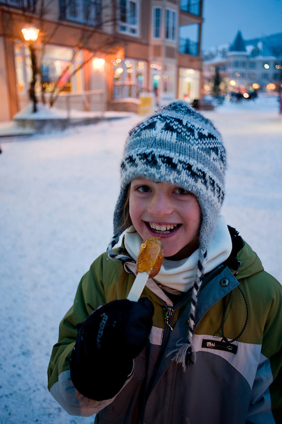 Boys eating a maple syrup snow popsicle. Ski Fest Tremblant Quebec, Canada