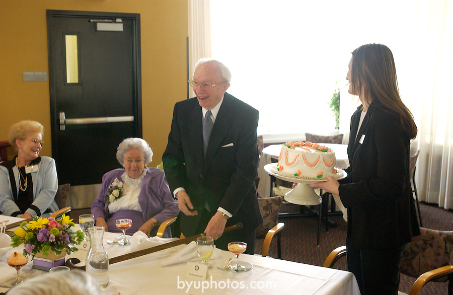DVD 493 April 2003 C<br /> Wedding Anniversary cake<br /> Marjorie Hinckley Endowed Chair in Social Work and the Social Sciences. FHSS Family Home and Social Sciences.<br /> President Gordon B. Hinckley, Merrill J. Bateman, PLC members, Ira Fulton, Jack Wheatley, Alan Ashton, Monson, Faust.<br /> April 29, 2003<br /> Photography Mark A. Philbrick