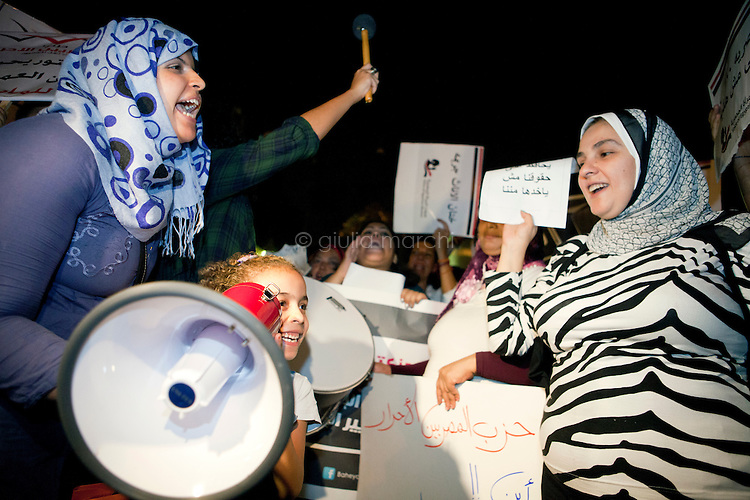 Women during a demonstration to demand that women's rights be protected in the new constitution, outside the Shura Council - the upper house of parliament in Cairo, Egypt. October 2nd, 2012.