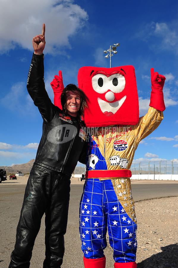 Apr. 1, 2012; Las Vegas, NV, USA: NHRA top fuel harley motorcycle rider Douglas Horne celebrates after winning the Summitracing.com Nationals at The Strip in Las Vegas. Mandatory Credit: Mark J. Rebilas-