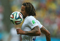 Jermaine Jones of USA is hit in the face with the ball