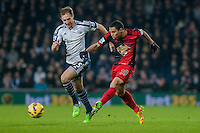 WEST BROMWICH, ENGLAND - FEBRUARY 11: Craig Dawson of West Bromwich Albion  and Jefferson Montero of Swansea City battle for the ball  during the Premier League match between West Bromwich Albion and Swansea City at The Hawthorns on February 11, 2015 in West Bromwich, England. (Photo by Athena Pictures/Getty Images)