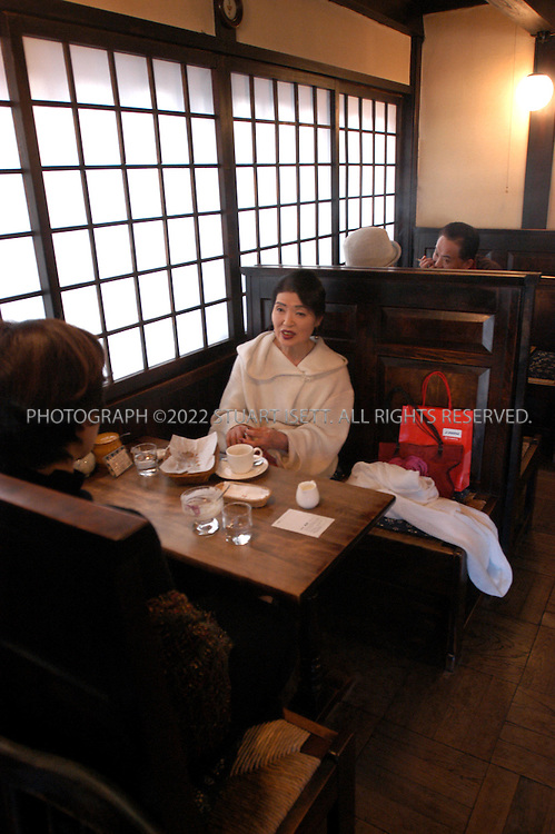 December 14, 2002, Matsumoto, Japan: The Marumo Coffee shop, one of Japan's oldest coffee; a place with an old world feeling, where classical music from a huge collection is played at a whisper-like volume on a stereo, waitresses murmur irrashaimase (welcome) with every entrance and departure, and a mostly prosperous, middle aged clientele gathers to exchange gossip.  Photograph by Stuart Isett ©2002 Stuart Isett All rights reserved. Credit: Stuart Isett / Polaris