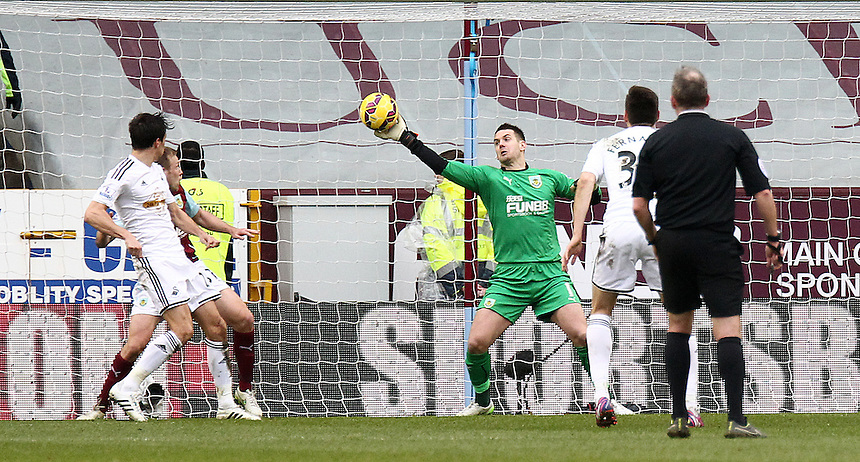 Swansea City's Jack Cork's shot on goal is saved by Burnley's Thomas Heaton, but Kieran Trippier's resulting touch pushes the ball over the line for an own goal<br /> <br /> Photographer Rich Linley/CameraSport<br /> <br /> Football - Barclays Premiership - Burnley v Swansea City - Friday 27th February 2015 - Turf Moor - Burnley<br /> <br /> &copy; CameraSport - 43 Linden Ave. Countesthorpe. Leicester. England. LE8 5PG - Tel: +44 (0) 116 277 4147 - admin@camerasport.com - www.camerasport.com