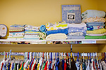 "A small store is filled with donated items, including blankets, clothing and more, for new mothers to purchase with their ""boutique bucks,"" which are earned by attending classes at the Pregnancy Aid Clinic in Hapeville, Georgia. The clinic offers women free support, including ultrasounds, pregnancy tests, classes, and supplies. Seen November 7, 2013."