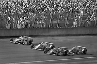 BROOKLYN, MI - AUGUST 2: Bobby Rahal (#3) drives his March 86C/Cosworth ahead of Rick Mears (#1), Michael Andretti (#18) and Kevin Cogan (#7) in the Michigan 500 on August 2, 1986, at Michigan International Speedway near Brooklyn, Michigan.