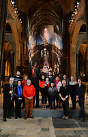 BNPS.co.uk (01202 558833)<br /> Pic: ZacharyCulpin/BNPS<br /> <br /> PICTURED: The cast and crew that helped put the nativity together.<br /> <br /> One of the UK's most historic cathedrals today unveiled a 40ft Renaissance-style photographic tableau as its nativity - with its very own clergy, volunteers and staff starring as figures from the Christian scene.<br /> <br /> Salisbury Cathedral's spectacular nativity features its stonemason as Joseph, a bookings agent as Mary, a retired postman as a shepherd, a Canon and guides as Wise Men - and the son of an ex-England rugby player as baby Jesus.<br /> <br /> The Wiltshire cathedral wanted to put a modern twist on the traditional Christmas scene and cast people as Nativity characters before holding a series of individual and group photoshoots.