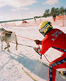 FINLAND, Hemet, Arctic, man having a reindeer race