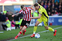Lincoln City's Harry Anderson vies for possession with Cheltenham Town's Chris Hussey<br /> <br /> Photographer Chris Vaughan/CameraSport<br /> <br /> The EFL Sky Bet League Two - Lincoln City v Cheltenham Town - Saturday 13th April 2019 - Sincil Bank - Lincoln<br /> <br /> World Copyright © 2019 CameraSport. All rights reserved. 43 Linden Ave. Countesthorpe. Leicester. England. LE8 5PG - Tel: +44 (0) 116 277 4147 - admin@camerasport.com - www.camerasport.com