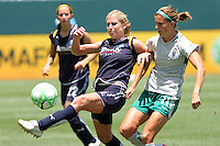 McCall Zerboni #6 of the Los Angeles Sol battles for control of the ball against Angie Woznuk #11 of the St. Louis Athletica during their WPS game at The Home Depot Center on July 8,2009 in Carson, California.  St. Louis defeated the Los Angeles Sol 1-0.