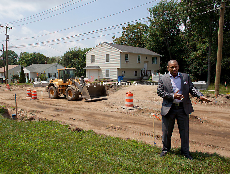 WATERBURY, CT-23 July 2014-072314BF11- Marc Morgan stands in front of his home at 1010 Pearl Lake Road. He said he has young children who have been awakened and also frightened by the noise of the construction. He said he is also concerned about the steep drop-off in front of his Waterbury home caused by the construction.  Bob Falcetti Republican-American