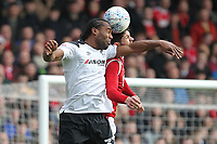 Nottingham Forest's Tobias Figueiredo in action with Derby County's Cameron Jerome<br /> <br /> Photographer Mick Walker/CameraSport<br /> <br /> The EFL Sky Bet Championship - Nottingham Forest v Derby County - Sunday 11th March 2018 - The City Ground - Nottingham<br /> <br /> World Copyright &copy; 2018 CameraSport. All rights reserved. 43 Linden Ave. Countesthorpe. Leicester. England. LE8 5PG - Tel: +44 (0) 116 277 4147 - admin@camerasport.com - www.camerasport.com