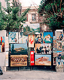 GREECE, Athens, an artist displays paintings for sale on the street in an area called Thissio