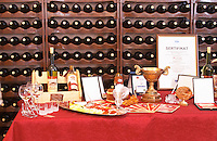 Display with bottles, diplomas glasses promotional material and appetizers., in the winery tasting room. Vukoje winery, Trebinje. Republika Srpska. Bosnia Herzegovina, Europe.
