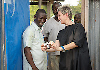 Occidental College professor Mary Beth Heffernan shows Dr. Jerry Brown his image on the back of a camera after taking his picture at the ELWA II ETU (Ebola Treatment Unit) in Monrovia, Liberia on Thursday, Feb. 26, 2015. The photos are part of Professor Heffernan's PPE Portrait Project, which was planned with the help of Dr. Brown, one of TIME magazine's Persons of the Year for his work during the Ebola outbreak in West Africa. Dr. Brown is the director of the ELWA II ETU.<br /> (Photo by Marc Campos, Occidental College Photographer) Mary Beth Heffernan, professor of art and art history at Occidental College, works in Monrovia the capital of Liberia, Africa in 2015. Professor Heffernan was there to work on her PPE (personal protective equipment) Portrait Project, which helps health care workers and patients fighting the Ebola virus disease in West Africa.<br />