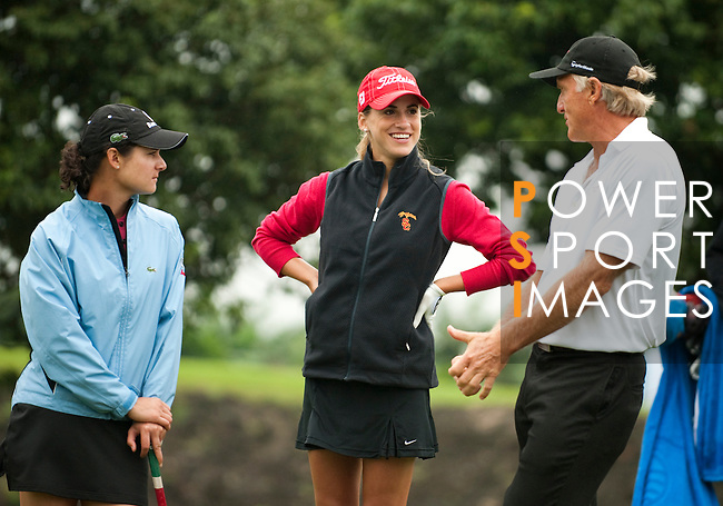 HAIKOU, CHINA - OCTOBER 27:  Lorena Ochoa (L) of Mexico, Belen Mozo (C) of Spain and golf legend Greg Norman laugh during practice ahead of the inaugural Mission Hills Star Trophy on October 27, 2010 in Haikou, China.  The Mission Hills Star Trophy is Asia's leading leisure liflestyle event and features Hollywood celebrities and international golf stars. Photo by Victor Fraile / The Power of Sport Images