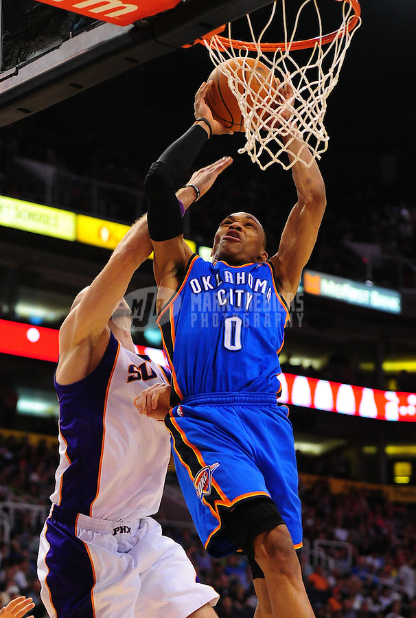 Mar. 30, 2011; Phoenix, AZ, USA; Oklahoma City Thunder guard (0) Russell Westbrook dunks the ball in the second half against the Phoenix Suns at the US Airways Center. The Thunder defeated the Suns 116-98. Mandatory Credit: Mark J. Rebilas-