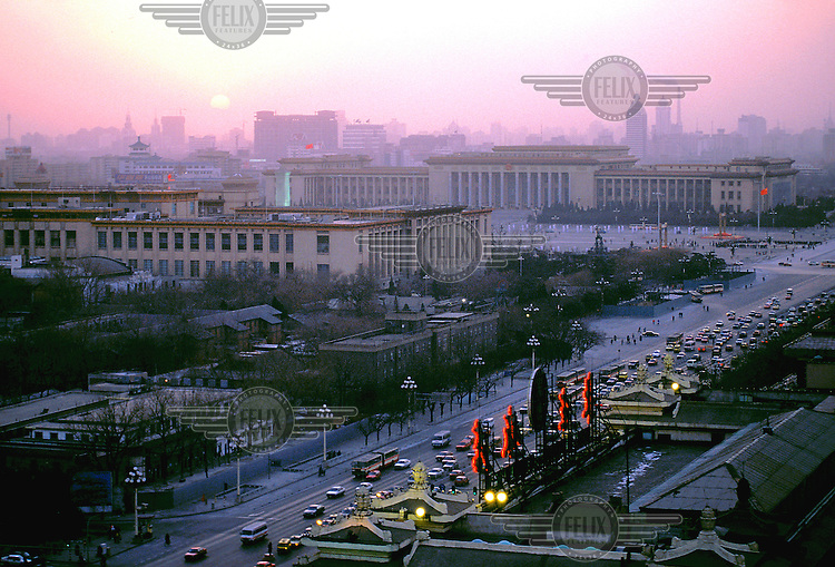 Mark Henley/Panos Pictures..China, Beijing..View at dusk over the city centre towards Tiananmen Square, with sun setting in pollution haze.