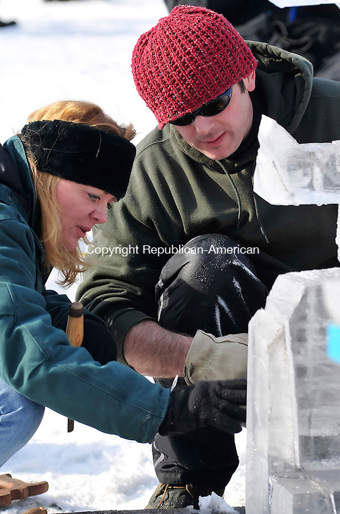 SALISBURY, CT- 07 February 2009 --020709JS11-Kristin Fredrickson of Sharon Springs, NY, left, and Jeremiah Bickford of Ashley Falls, MA, works on their ice sculpture during the eighth annual Ice Carving competition Saturday at the White Hart Inn in Salisbury. The event is held as part of the annual Ski Jump weekend. The event is sponsored by Klemm Real Estate, the White Hart Inn and the Salisbury Winter Sports Association. <br /> Jim Shannon / Republican-American
