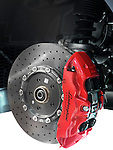 Closeup of Lamborghini sports car front ceramic brakes, a disc and a caliper