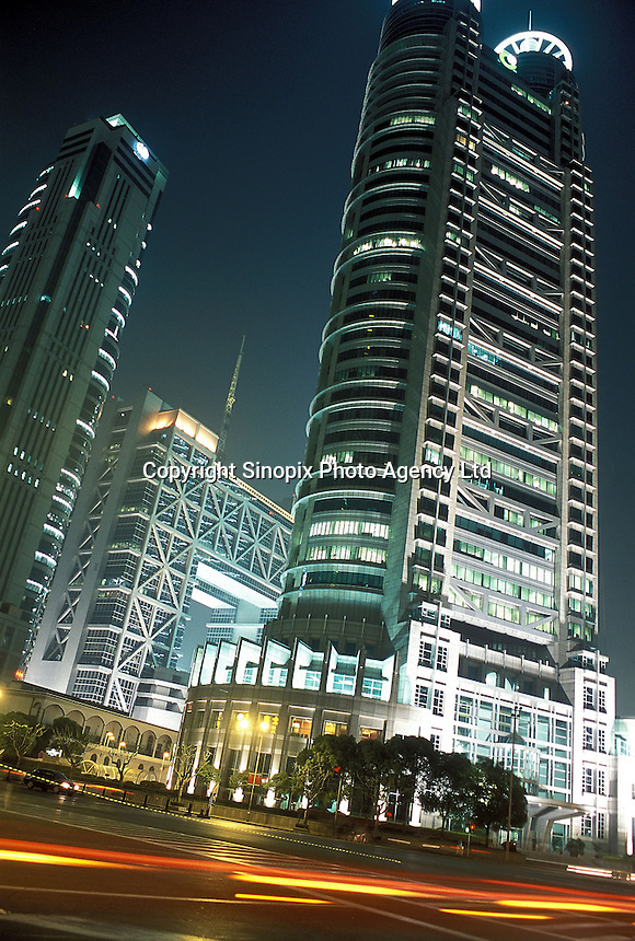 The square shaped Shanghai Stock Exchange Building is lit up at night in the Pudong commercial hub of Shanghai, China..