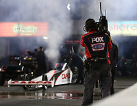 Apr 20, 2018; Baytown, TX, USA; A Fox Sports TV cameraman films NHRA top fuel driver Steve Torrence during qualifying for the Springnationals at Royal Purple Raceway. Mandatory Credit: Mark J. Rebilas-USA TODAY Sports