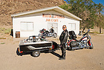 Men on Harley Davidson motorcycles stop for a break during their travels at the old Warm Springs Bar & Cafe