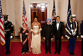 Washington, DC - November 24, 2009 -- United States President Barack Obama, second right, and U.S. First Lady Michele Obama, third from left, pose for a photograph in the Crosshall of the White House with Manmohan Singh, India's prime minister, third from right, and his wife Gursharan Kaur, second from left, in Washington, D.C., U.S., on Tuesday, November 24, 2009. Obama welcomed IndiaÌs role as a rising and responsible global power, saying the U.S. will follow through on a civilian nuclear agreement and work to expand trade and investment ties with the worldÌs largest democracy. .Credit: Andrew Harrer - Pool via CNP