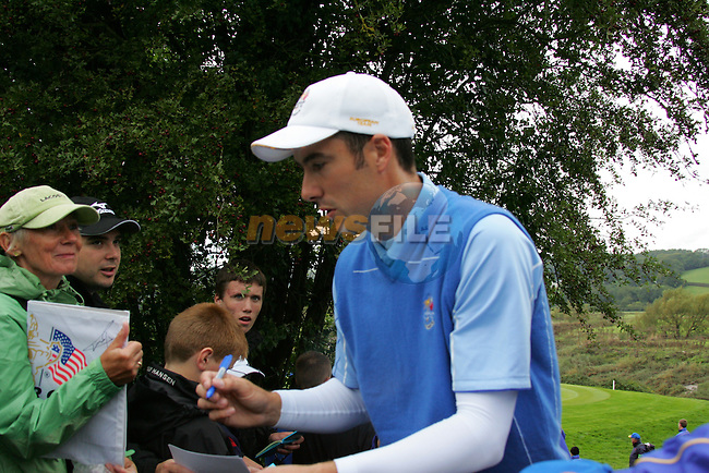 Ross Fisher signs autographs during Practice Day 2 at the 2010 Ryder Cup at the Celtic Manor Twenty Ten Course, Newport, Wales, 29th September 2010..(Picture Eoin Clarke/www.golffile.ie)