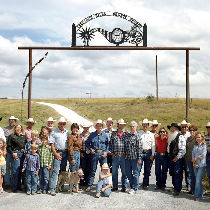 ed Cowboy Church. Texas, USA. 2007. The congregation of the 1,000 Hills Cowboy Church under the distinctive western metal sign at the entrance to the Cowboy Church.