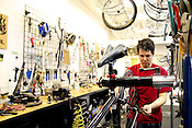 May 15, 2009. Chapel Hill, NC..The Bicycle Chain on Franklin St. in Chapel Hill offers a wide selection of bicycles for every experience level and terrain along with repair services.  Lincoln Sward adjusts a tire brought in for repairs.
