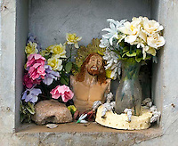 Jesus bust at a grave at the old Mexican cemetery in Tubac Arizona.