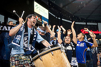 Kansas City fans cheer on their team during a rain delay before the game at Livestrong Sporting Park in Kansas City, Kansas.   Sporting Kansas City won the Lamar Hunt U.S. Open Cup on penalty kicks after tying the Seattle Sounders in overtime.