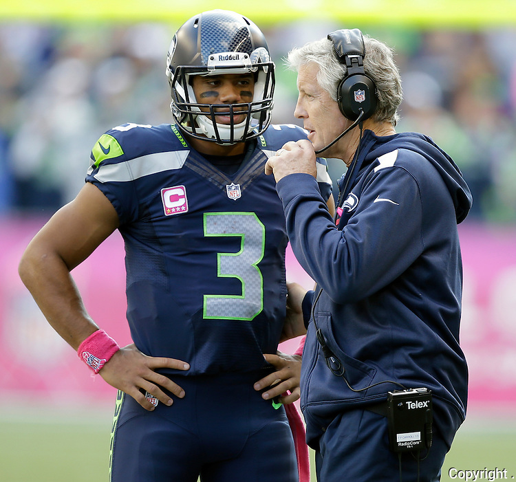 Seattle Seahawks head coach Pete Carroll, right, and quarterback Russell Wilson talk during a time out called against the Tennessee Titans in the fourth quarter at CenturyLink Field in Seattle, Washington on  October13, 2013.  The Seahawks beat the Titians 20-13.    ©2013. Jim Bryant Photo. All Rights Reserved.