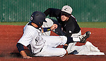 February 22, 2013: Nevada Wolf Pack runner Scott Kaplan is taged out by Northern Illinois Huskies shortstop Brian Sisler during their NCAA baseball game played at Peccole Park on Friday afternoon in Reno, Nevada.