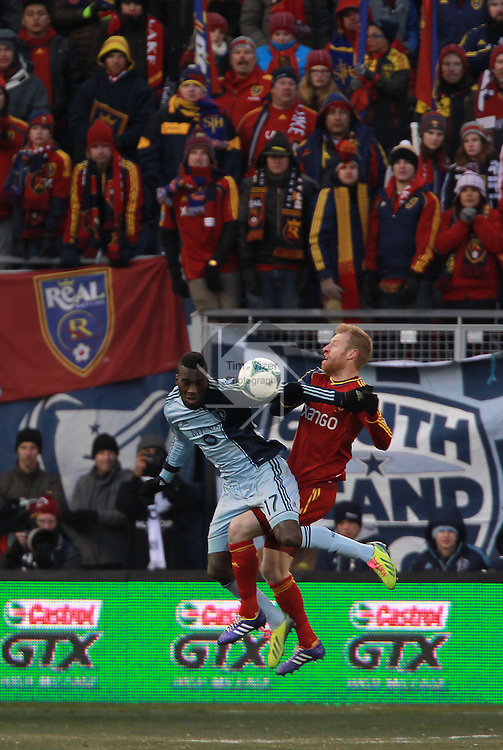 Sporting KC forward C.J. Sapong (17) and Real Salt Lake defender Nat Borchers (6) tangle as a huge crowd of Real Salt Lake fans watch. Sporting KC defeated Real Salt Lake in a shootout after the score was tied 1-1 at the end of regulation play in the MLS Cup 2013 championship held at Sporting Park in Kansas City, Kansas on Saturday December 7, 2013.