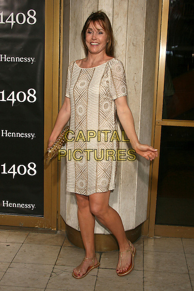 "ALEX DONNELLEY.""1408"" World Premiere at Mann's National Theatre, Westwood, California, USA..June 12th, 2007.full length beige gold print dress flip flops sandals clutch purse .CAP/ADM/BP.©Byron Purvis/AdMedia/Capital Pictures"